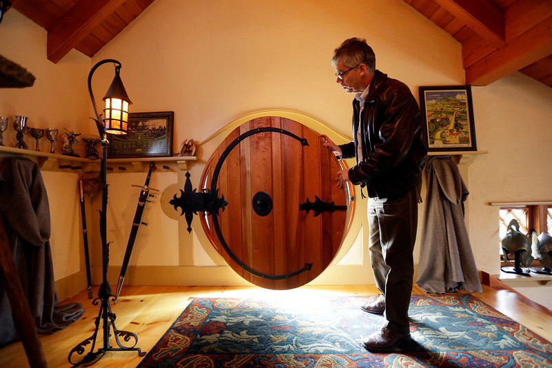 . Architect Peter Archer closes the front door of the ìHobbit Houseî during and interview with the Associated Press Tuesday, Dec. 11, 2012, in Chester County, near Philadelphia.  Archer has designed a ìHobbit Houseî containing a world-class collection of J.R.R. Tolkien manuscripts and memorabilia. (AP Photo/Matt Rourke)