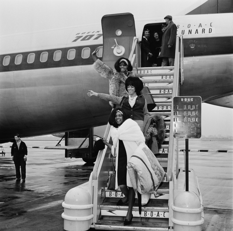 . American Motown vocal group The Supremes arriving at London Airport (now Heathrow), London, 15th March 1965. From top to bottom: Diana Ross, Florence Ballard and Mary Wilson. The group are in the UK to take part in the Tamla-Motown Revue tour. (Photo by Evening Standard/Hulton Archive/Getty Images)