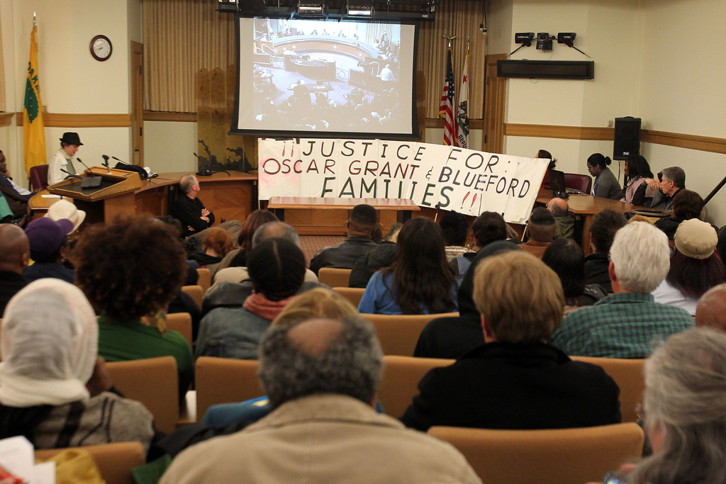 ". Oakland residents watch the Oakland City Council meeting broadcast live in a room as they wait on the vote to hire former NYPD and LAPD chief William Bratton as a consultant to help reduce crime at Oakland City Hall in Oakland, Calif., on Tuesday, Jan. 22, 2013. Some Oakland residents opposed to Bratton\'s ""stop and frisk\"" tactics that he had used in his previous tenures as top chief in New York and Los Angeles. (Ray Chavez/Staff)"