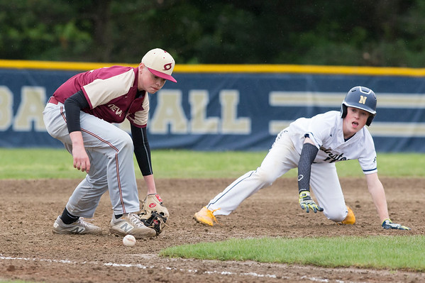 05/14/19 Wesley Bunnell | Staff Newington baseball defeated New Britain 4-3 in a walk off on Tuesday afternoon at Newington High School. Chris Gibbs (7) eyes the ball as it gets away from him on a play at third.
