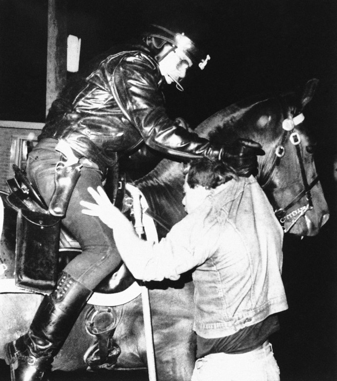 . A mounted policeman collars a fan outside Tiger Stadium in Detroit on Oct. 14, 1984 during a demonstration that included burning cars following the Detroit win in the World Series. (AP Photo/Ron Heflin)