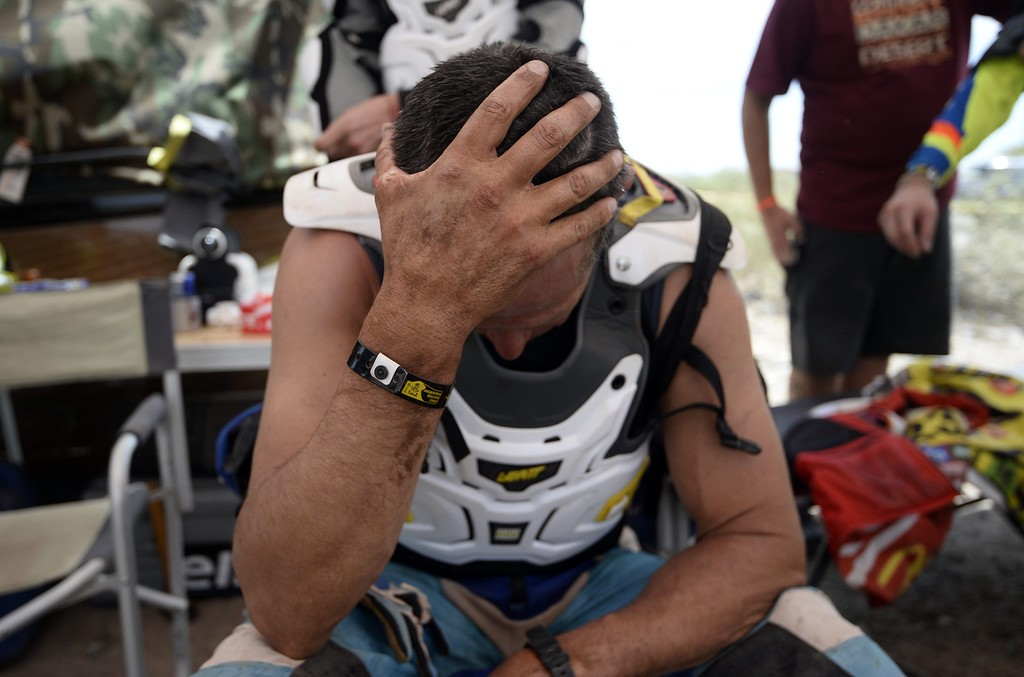 . A biker rests at the end of stage 2 of the Dakar 2015 between Carloz Paz and San Juan, Argentina, on January 5, 2015. FRANCK FIFE/AFP/Getty Images