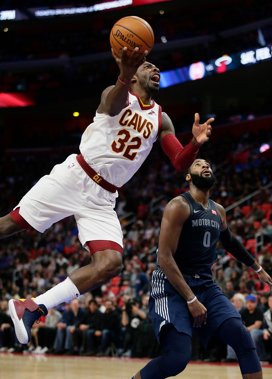 . Cleveland Cavaliers forward Jeff Green (32) goes to the basket past Detroit Pistons center Andre Drummond (0) during the second half of an NBA basketball game Tuesday, Jan. 30, 2018, in Detroit. The Pistons defeated the Cavaliers 125-114. (AP Photo/Duane Burleson)