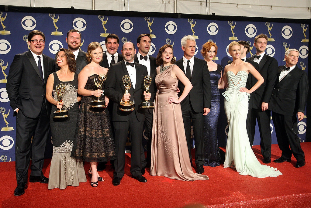 """. The cast and crew of \""""Mad Men\"""" pose with their Emmy for Oustanding Drama Series in the press room at the 61st Primetime Emmy Awards held at the Nokia Theatre on September 20, 2009 in Los Angeles, California.  (Photo by Jason Merritt/Getty Images)"""