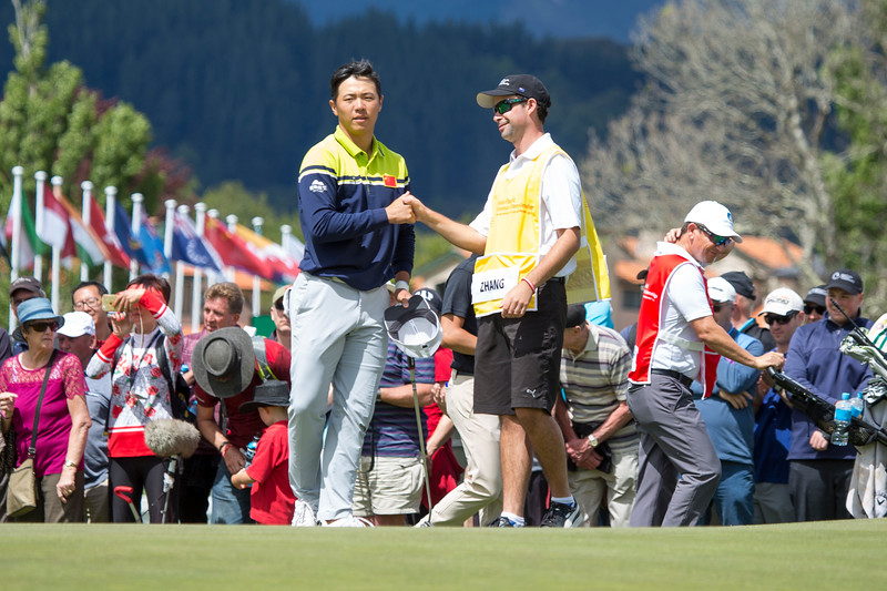 Andy Zhang from China with his caddy Ben Slaven after completing his round on the final day of the Asia-Pacific Amateur Championship tournament 2017 held at Royal Wellington Golf Club, in Heretaunga, Upper Hutt, New Zealand from 26 - 29 October 2017. Copyright John Mathews 2017.   www.megasportmedia.co.nz