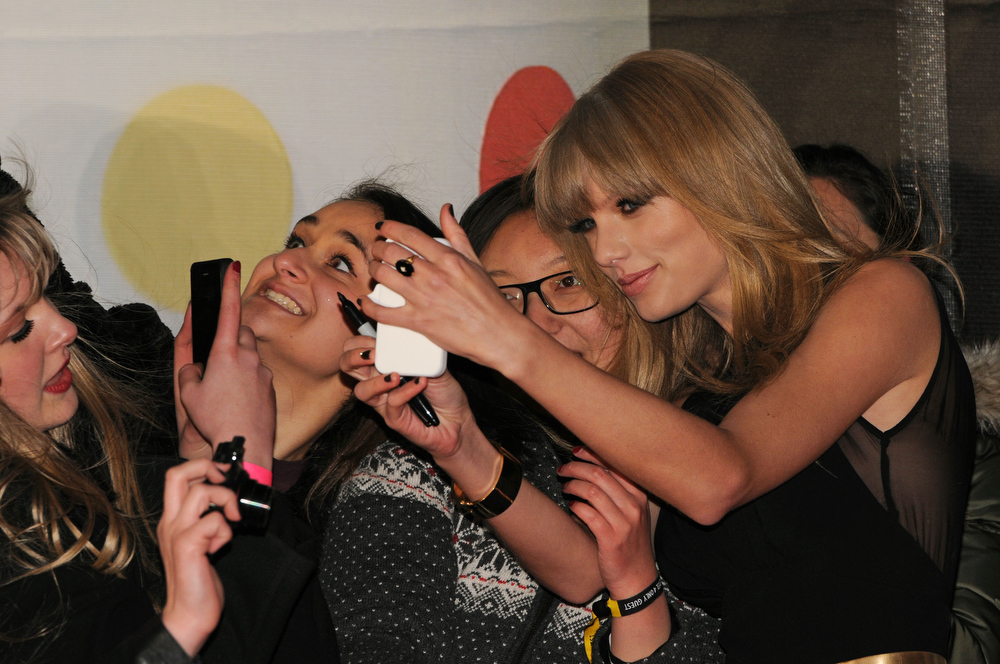 Description of . Taylor Swift takes photos with fans at the Brit Awards 2013 at the 02 Arena on February 20, 2013 in London, England.  (Photo by Eamonn McCormack/Getty Images)
