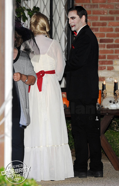 Courteney Cox Terrifying In Annabelle Halloween Costume With Johnny McDaid As Dracula!
