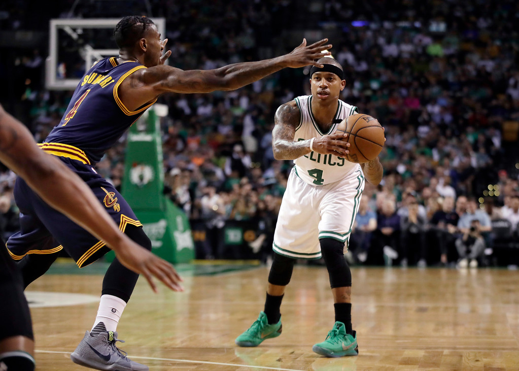 . Boston Celtics guard Isaiah Thomas looks to pass the ball as Cleveland Cavaliers guard Iman Shumpert, left, defends during the first half of Game 2 of the NBA basketball Eastern Conference finals, Friday, May 19, 2017, in Boston. Thomas did not return in the second half due to a strained right hip. (AP Photo/Elise Amendola)