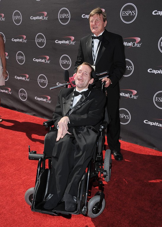. Dick Hoyt, rear, and son Rick Hoyt arrive at the ESPY Awards on Wednesday, July 17, 2013, at Nokia Theater in Los Angeles. (Photo by Jordan Strauss/Invision/AP)