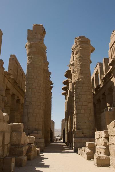 Pillars and narrow hallways at Karnak Temple - Luxor, Egypt