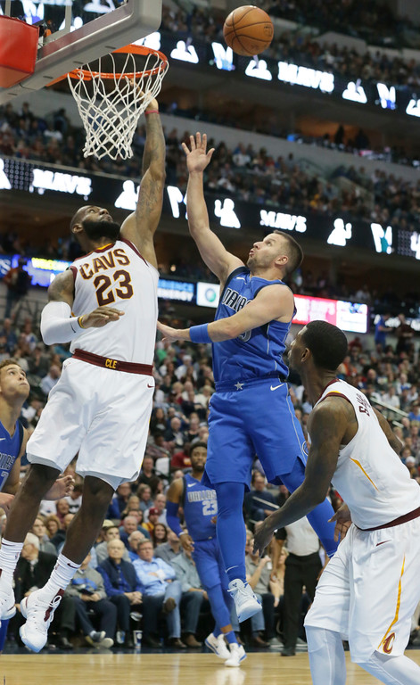 . Dallas Mavericks guard J.J. Barea (5) shoots against Cleveland Cavaliers forward LeBron James (23) during the second half of an NBA basketball game in Dallas, Saturday, Nov. 11, 2017. (AP Photo/LM Otero)
