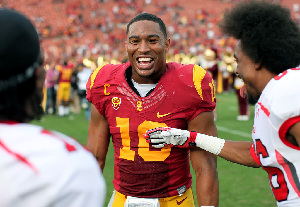 . USC\'s Hayes Pullard jokes with Utah players after the game, Saturday, October 26, 2013, at the L.A. Memorial Coliseum. (Michael Owen Baker/L.A. Daily News)