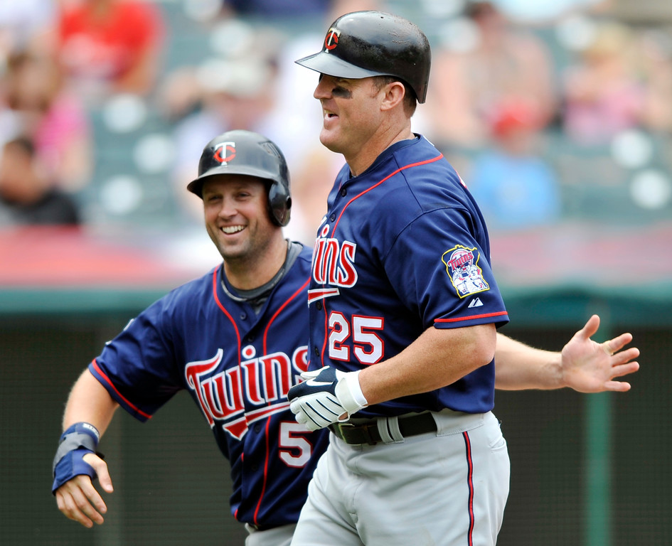 . Minnesota Twins\' Jim Thome, right, is congratulated by teammate Michael Cuddyer after hitting a two-run home run against the Cleveland Indians in a baseball game in Cleveland, Sunday, Aug. 8, 2010. (AP Photo/David Richard)