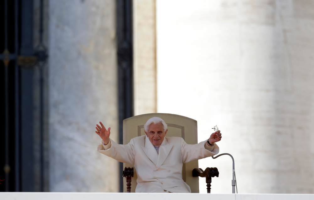 "Description of . Pope Benedict XVI waves to faithful during his final general audience in St.Peter\'s Square at the Vatican, Wednesday, Feb. 27, 2013. Pope Benedict XVI has recalled moments of ""joy and light\"" during his papacy but also times of great difficulty in an emotional, final general audience in St. Peter\'s Square before retiring. (AP Photo/Gregorio Borgia)"