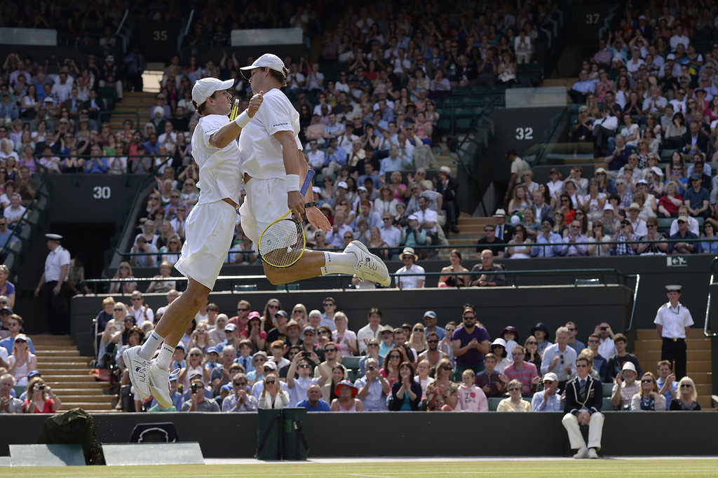 . US players Bob Bryan (R) and Mike Bryan (L) do their trademark chest bump celebration after beating India\'s Rohan Bopanna and France\'s Edouard Roger-Vasselin in their men\'s doubles semi-final match on day ten of the 2013 Wimbledon Championships tennis tournament at the All England Club in Wimbledon, southwest London, on July 4, 2013. ADRIAN DENNIS/AFP/Getty Images
