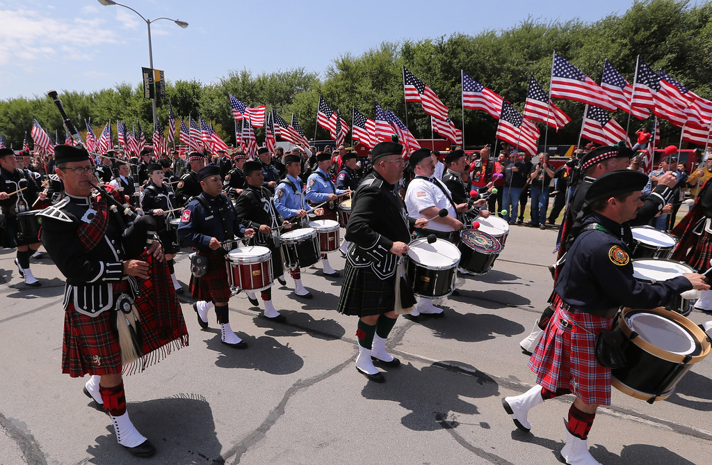. Bagpipers from across the country march in  a procession  to a memorial service for first responders who died in last week\'s fertilizer plant explosion in West, Texas, Thursday, April 25, 2013, in Waco, Texas. (AP Photo/Waco Tribune Herald, Rod Aydelotte)