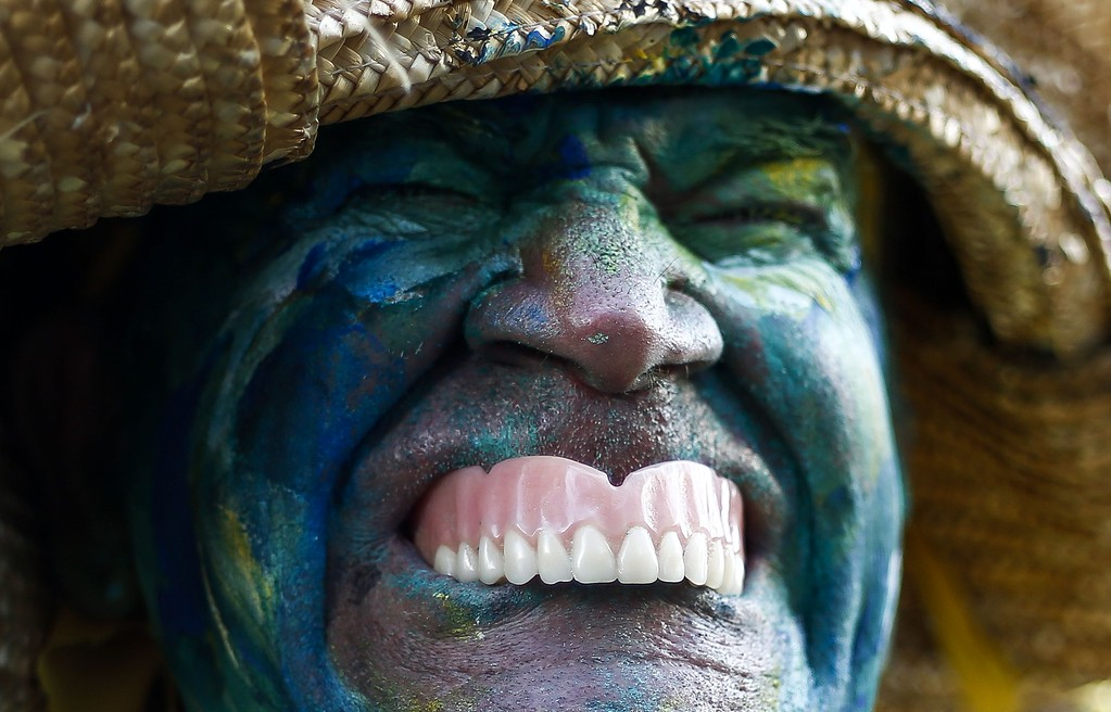 . TOPSHOTS A man in costume is seen before the 90th Sao Silvestre international 15 km race in Sao Paulo, Brazil, on 31 December 2014. Thirty thousand runners participated in the 15 km traditional New Year\'s Eve event. AFP PHOTO/Miguel SCHINCARIOLMiguel Schincariol/AFP/Getty Images