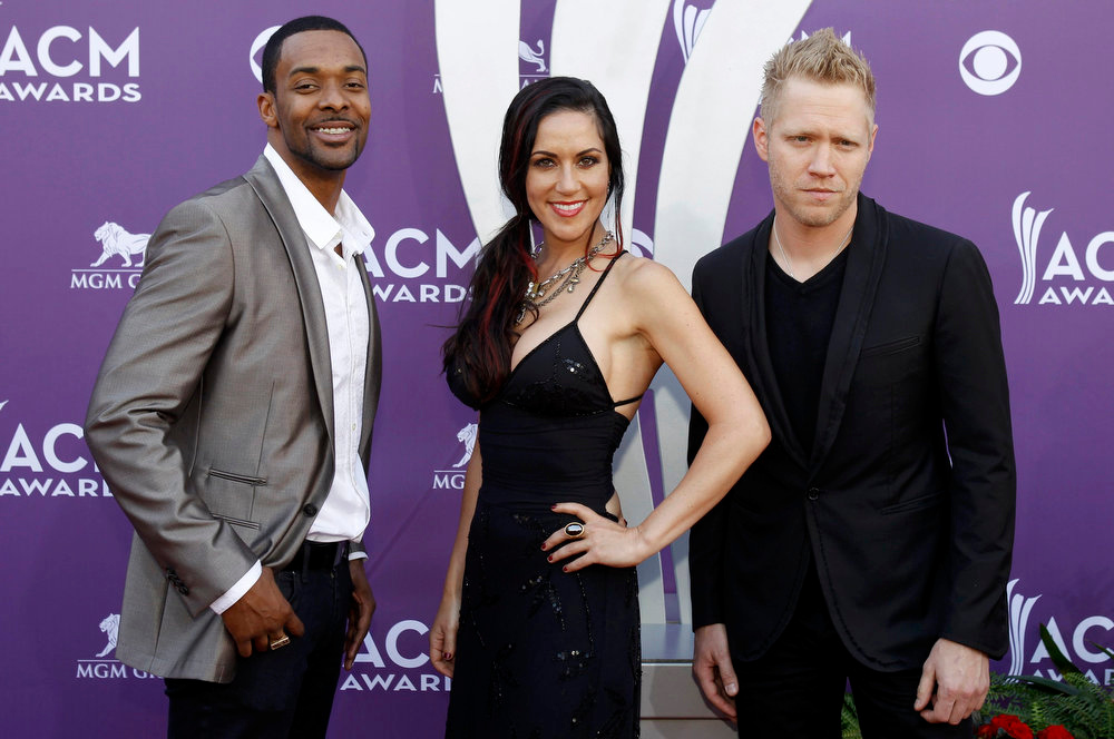 . Damien Horne (L), Krista Marie and Nick Hoffman, of the band The Farm, arrive at the 48th ACM Awards in Las Vegas April 7, 2013. REUTERS/Steve Marcus