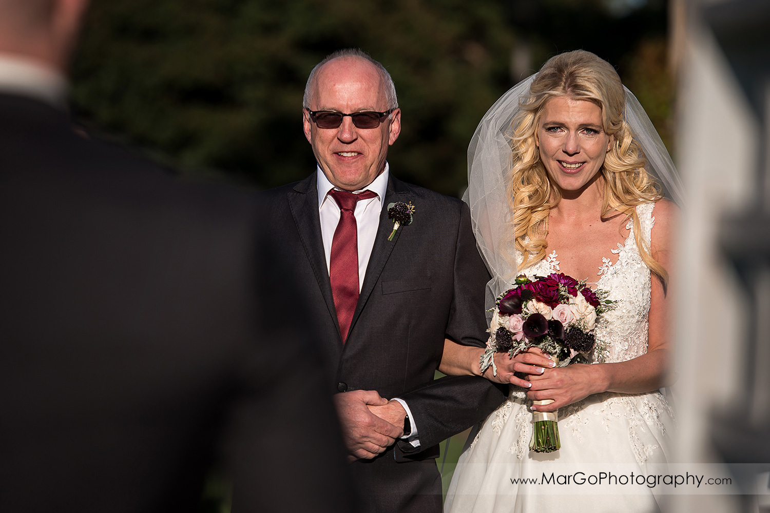 bride and her father going down the aisle during wedding ceremony at San Diego Marina Village
