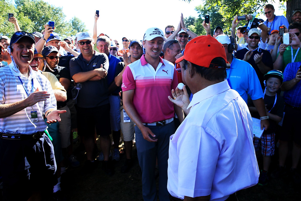 . ROCHESTER, NY - AUGUST 10:  Jonas Blixt of Sweden talks with Muhammad Khokhar of Rochester after a wayward tee shot landed in Khokar\'s pocket on the 18th hole during the third round of the 95th PGA Championship on August 10, 2013 in Rochester, New York.  (Photo by David Cannon/Getty Images)