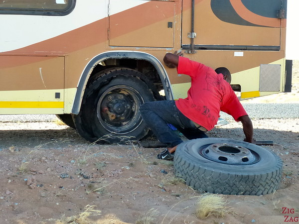 changing tires on the roads of Namibia