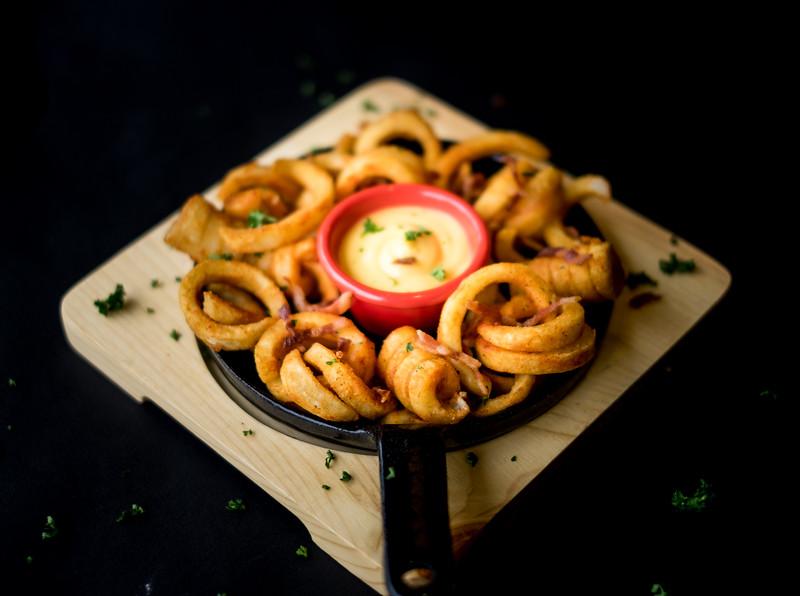 Food-curlyfries black background.jpg