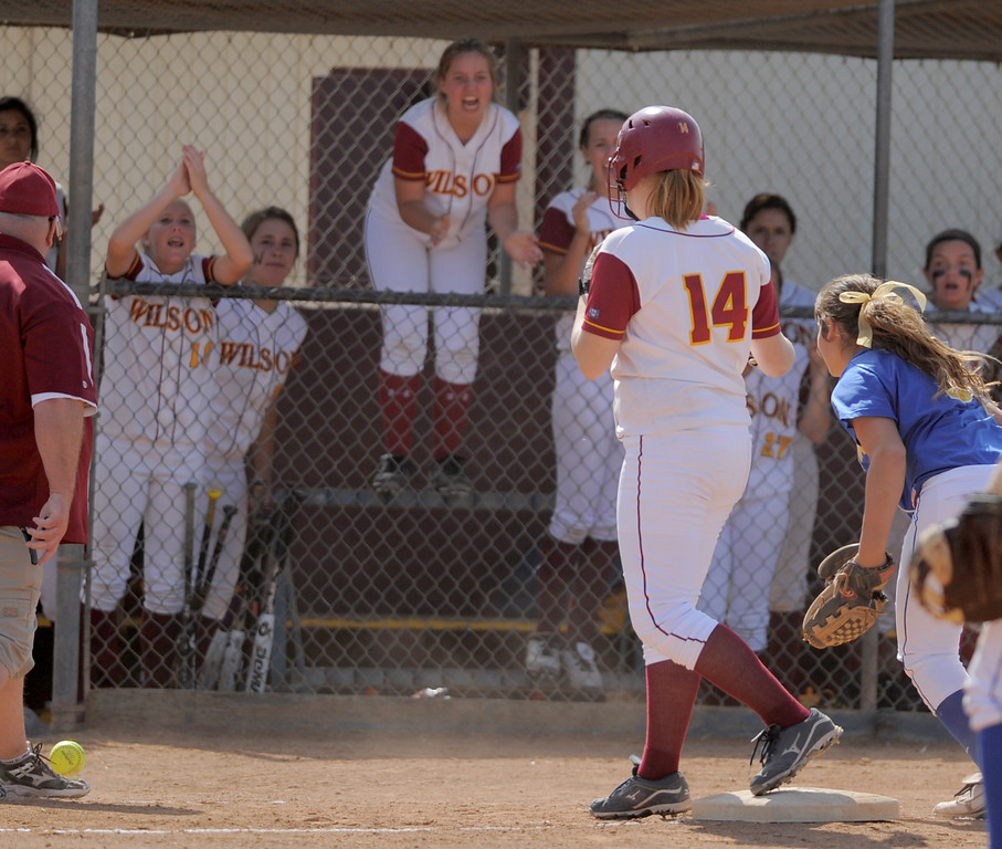 . 05-16-2013-( Daily Breeze Staff Photo by Sean Hiller) Wilson vs. El Toro in the opening round of the CIF-SS D2 playoffs Thursday at Joe Rodgers Field in Long Beach. Alexis Schiff gets cheered after hitting a triple for Wilson.