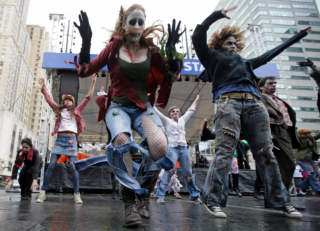 . A group billed as the Dancing Dead perform to the song Thriller, during the annual Halloween Costume Contest, Thursday, Oct. 31, 2013, on Fountain Square in downtown Cincinnati. (AP Photo/Al Behrman)