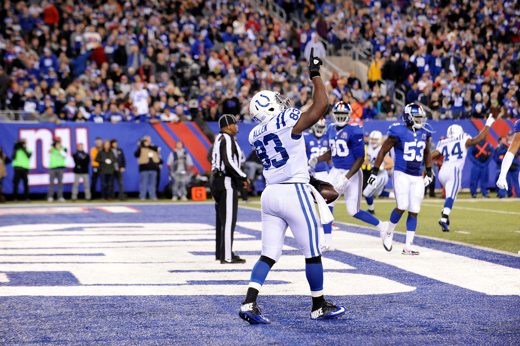 . Indianapolis Colts tight end Dwayne Allen (83) celebrates after catching a pass for a touchdown during the second half of an NFL football game against the New York Giants, Monday, Nov. 3, 2014, in East Rutherford, N.J. (AP Photo/Bill Kostroun)