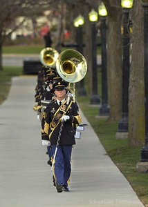 Members of the Michigan National Guard's 126th Army Band out of Wyoming, Mich. march toward the Gerald R. Ford Museum Tuesday, January 2, 2007 in Grand Rapids, MI. (Press Photo/Emily Zoladz)
