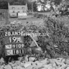NJ910919A, Man marking Ordnance Survey minor control revision point with an arrow in 1950s