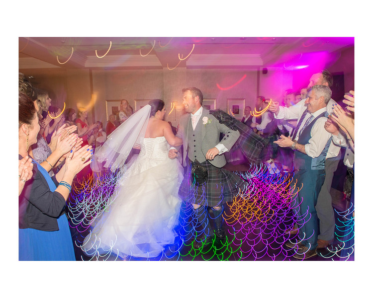 Wedding Photography of Louise & Jason, Dunfries Arms Hotel, Scotland, Photograph is of the Bride & Groom dancing in the middle of the guests