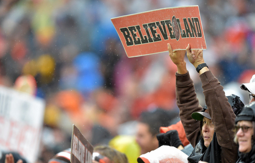 . A Cleveland Browns fan holds up a sign during the first half of an NFL football game between the Cleveland Browns and the Pittsburgh Steelers, Sunday, Sept. 9, 2018, in Cleveland. (AP Photo/David Richard)