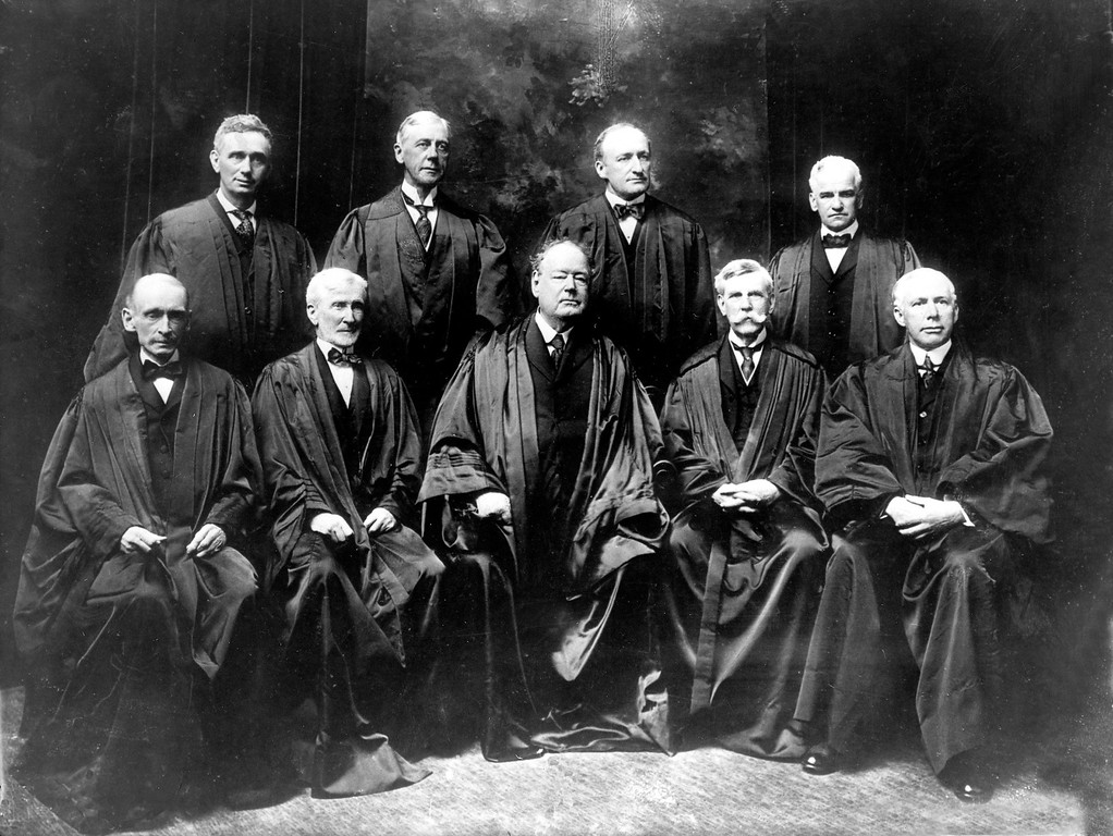 . The nine members of the U.S. Supreme Court pose in their robes in New York City in 1917.  Standing from left are, Justice Louis D. Brandeis, Mahlon Pitney, James C. McReynolds and John H. Clarke.  Seated from left are, William R. Day, Joseph McKenna, Chief Justice Edward D. White, Oliver Wendell Holmes, and, W. Van Devanter.  (AP Photo)