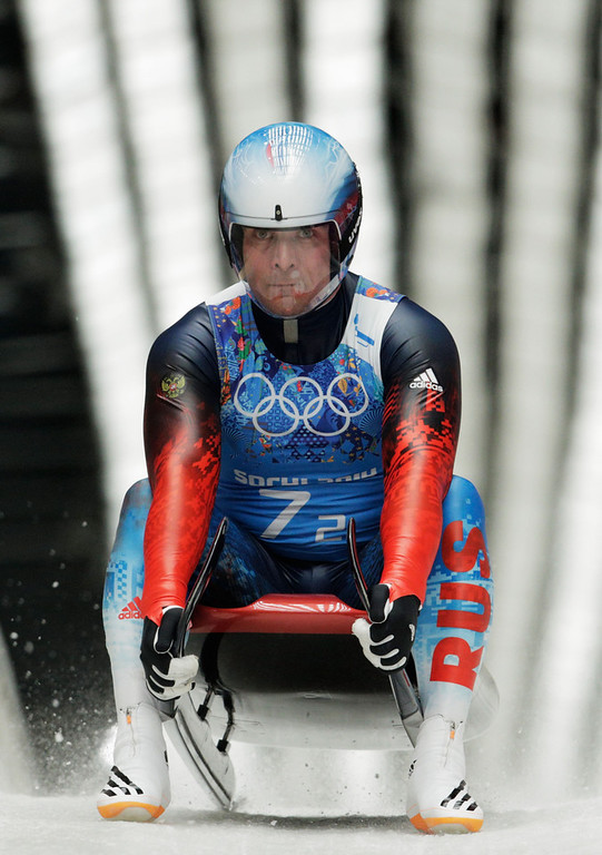 . Albert Demchenko of Russia finishes a run during the Luge Relay on Day 6 of the Sochi 2014 Winter Olympics at Sliding Center Sanki on February 13, 2014 in Sochi, Russia.  (Photo by Adam Pretty/Getty Images)