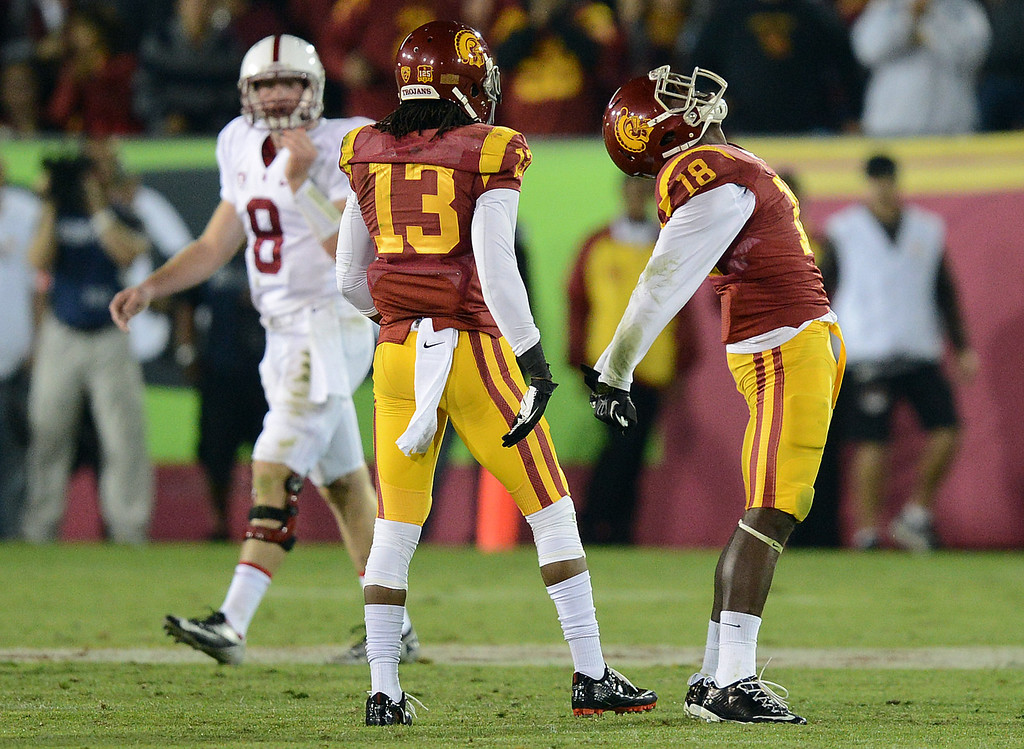 . USC�s Dion Bailey #18 reacts after intercepting a Stanford\'s Kevin Hogan #8 pass in the second half during their game at the Los Angeles Memorial Coliseum Saturday, November 16, 2013. USC beat Stanford 20-17. (Photos by Hans Gutknecht/Los Angeles Daily News)