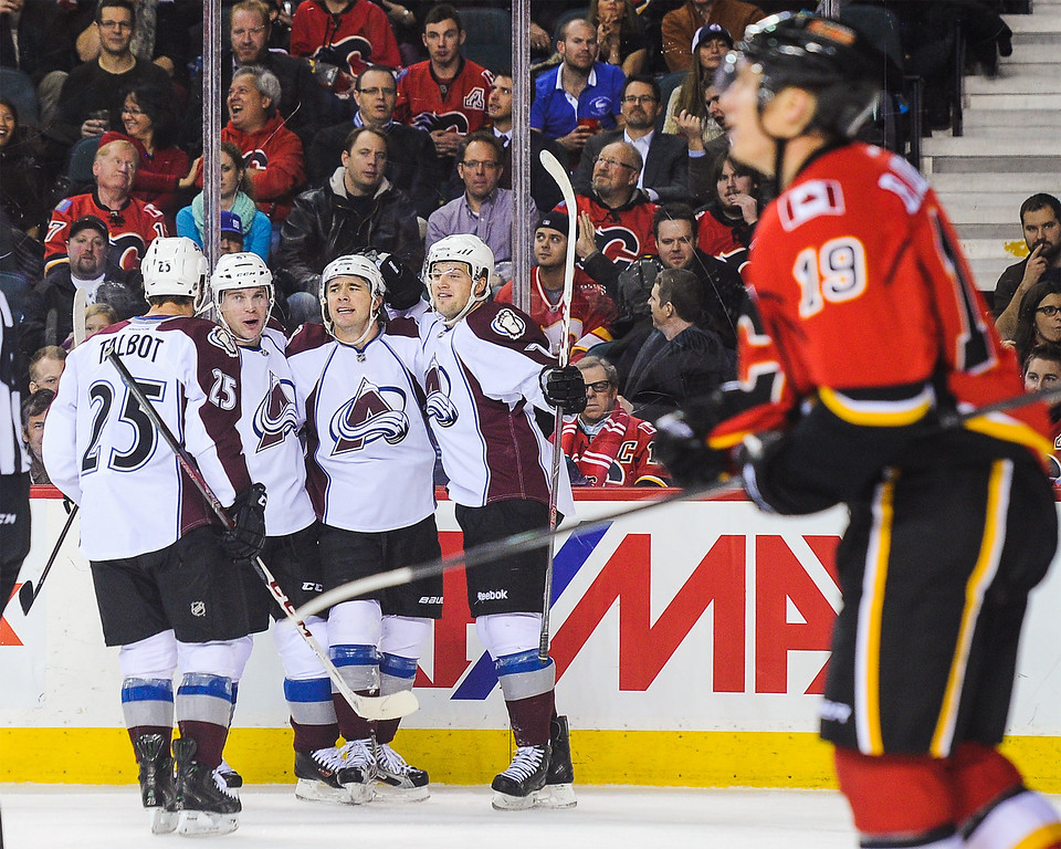 . CALGARY, AB - DECEMBER 6: P.A. Parenteau #15 of the Colorado Avalanche celebrates scoring his team\'s second goal against the Calgary Flames during an NHL game at Scotiabank Saddledome on December 6, 2013 in Calgary, Alberta, Canada. (Photo by Derek Leung/Getty Images)