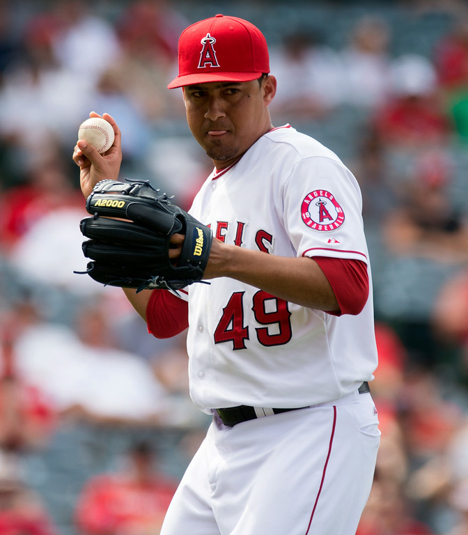 . Angels\' Ernesto Frieri throws over to first base after getting a hit back at Angel Stadium in Anaheim on Thursday June 26, 2014. The Angels beat the Minnesota Twins 6-4. (Photo by Keith Durflinger/Whittier Daily News)