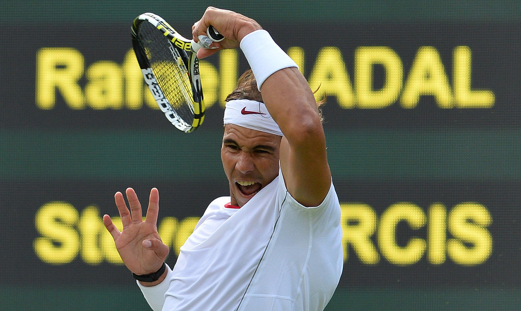 . Spain\'s Rafael Nadal returns against Belgium\'s Steve Darcis during their men\'s first round match on day one of the 2013 Wimbledon Championships tennis tournament at the All England Club in Wimbledon, southwest London, on June 24, 2013.  BEN STANSALL/AFP/Getty Images