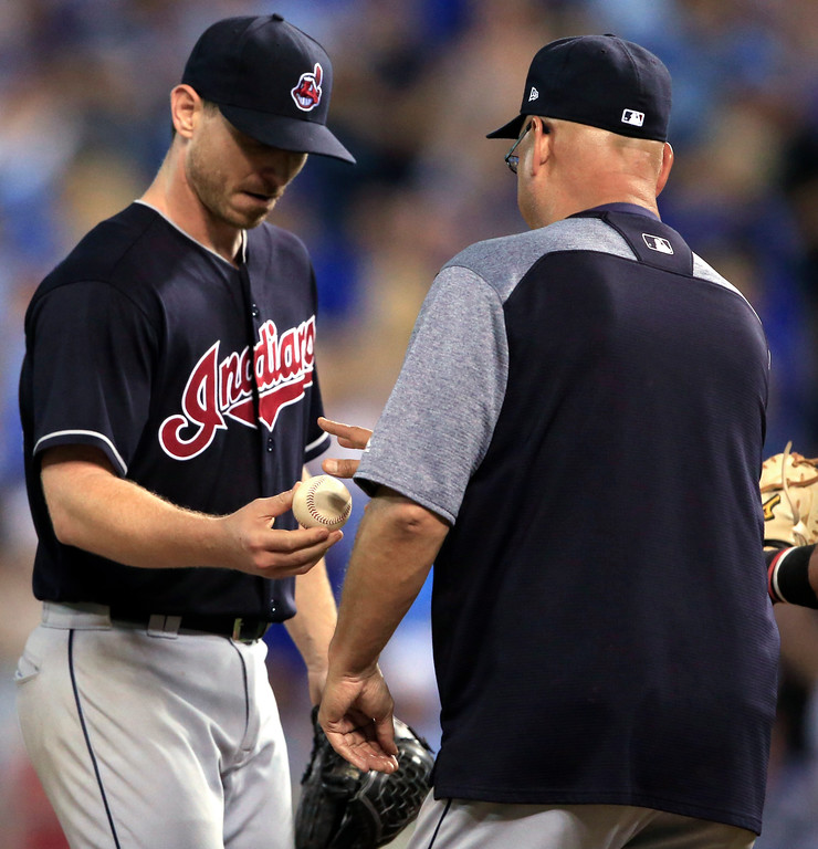. Cleveland Indians starting pitcher Josh Tomlin, left, hands the ball to manager Terry Francona, right, during the eighth inning of the team\'sp baseball game against the Kansas City Royals at Kauffman Stadium in Kansas City, Mo., Friday, June 2, 2017. The Royals defeated the Indians 4-0. (AP Photo/Orlin Wagner)