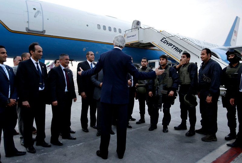 . U.S. Secretary of State John Kerry says goodbye to staff and security in Cairo, Egypt en route to Riyadh, Saudi Arabia, Sunday, March 3, 2013. Kerry met with Egypt\'s president Sunday, wrapping up a visit to the deeply divided country with an appeal for unity and reform. The U.S. is deeply concerned that continued instability in Egypt will have broader consequences in a region already rocked by unrest. (AP Photo/Jacquelyn Martin, Pool)
