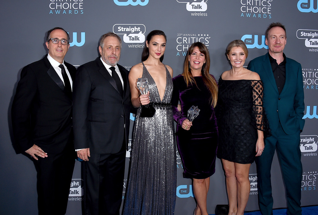 ". The cast and crew of ""Wonder Woman\"", winners of the award for best action film, pose in the press room at the 23rd annual Critics\' Choice Awards at the Barker Hangar on Thursday, Jan. 11, 2018, in Santa Monica, Calif. (Photo by Jordan Strauss/Invision/AP)"