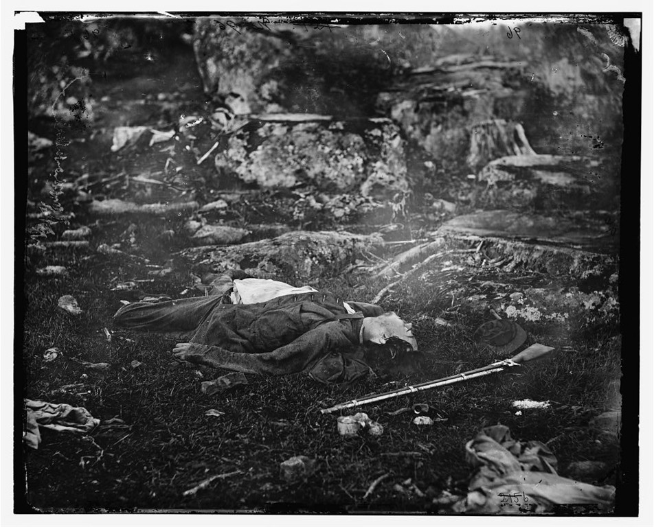 ". Gettysburg, Pennsylvania. Dead Confederate sharpshooter in ""The devil\'s den.\"" (Gardner, Alexander, 1821-1882, photographer)  - Library of Congress Prints and Photographs Division Washington, D.C."