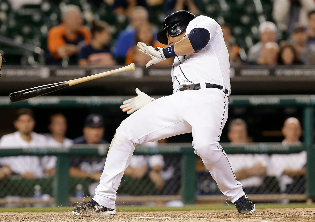 . Detroit Tigers\' Miguel Cabrera backs away from a inside pitch from New York Yankees relief pitcher Dellin Betances  in the ninth inning of a baseball game in Detroit, Wednesday, Aug. 27, 2014. The Yankees won 8-4. (AP Photo/Paul Sancya)