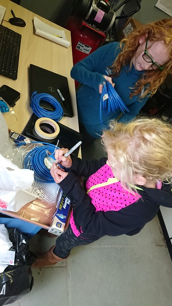 Izzy and Lily labeling new cables being installed at the KCUR Transmitter site.