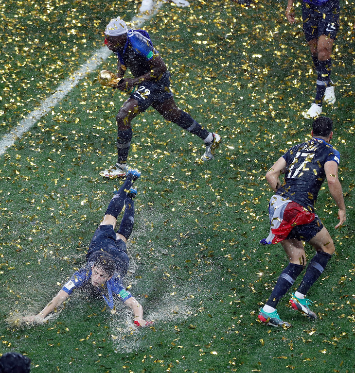 . French players celebrate after winning the final match between France and Croatia at the 2018 soccer World Cup in the Luzhniki Stadium in Moscow, Russia, Sunday, July 15, 2018. (AP Photo/Frank Augstein)