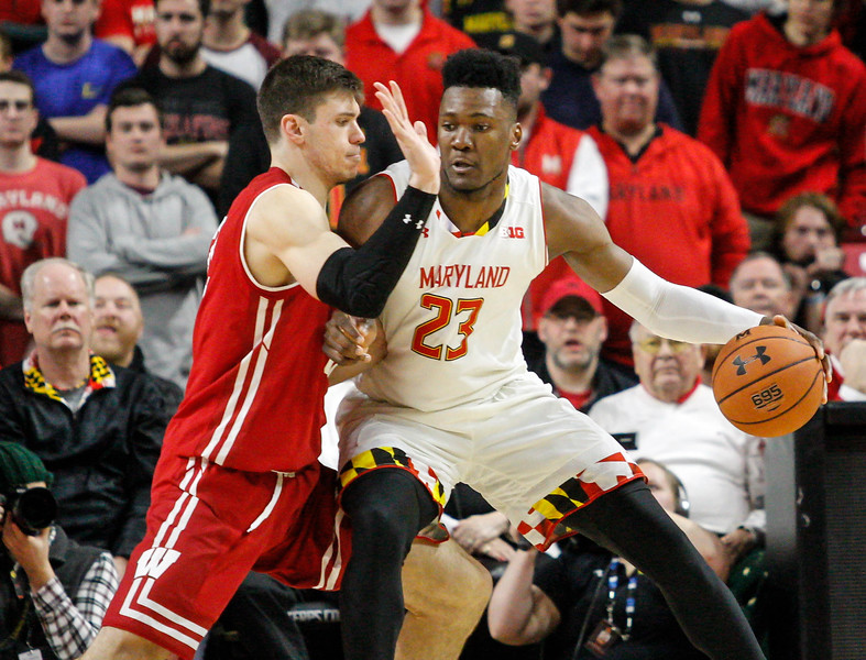January 20, 2018: Maryland forward Bruno Fernando (23) tries to maneuver around Wisconsin forward Ethan Happ (22) during BIG Ten Men Basketball action between University of Wisconsin and University of Maryland in College Park. Photo by: Chris Thompkins/Prince Georges Sentinel