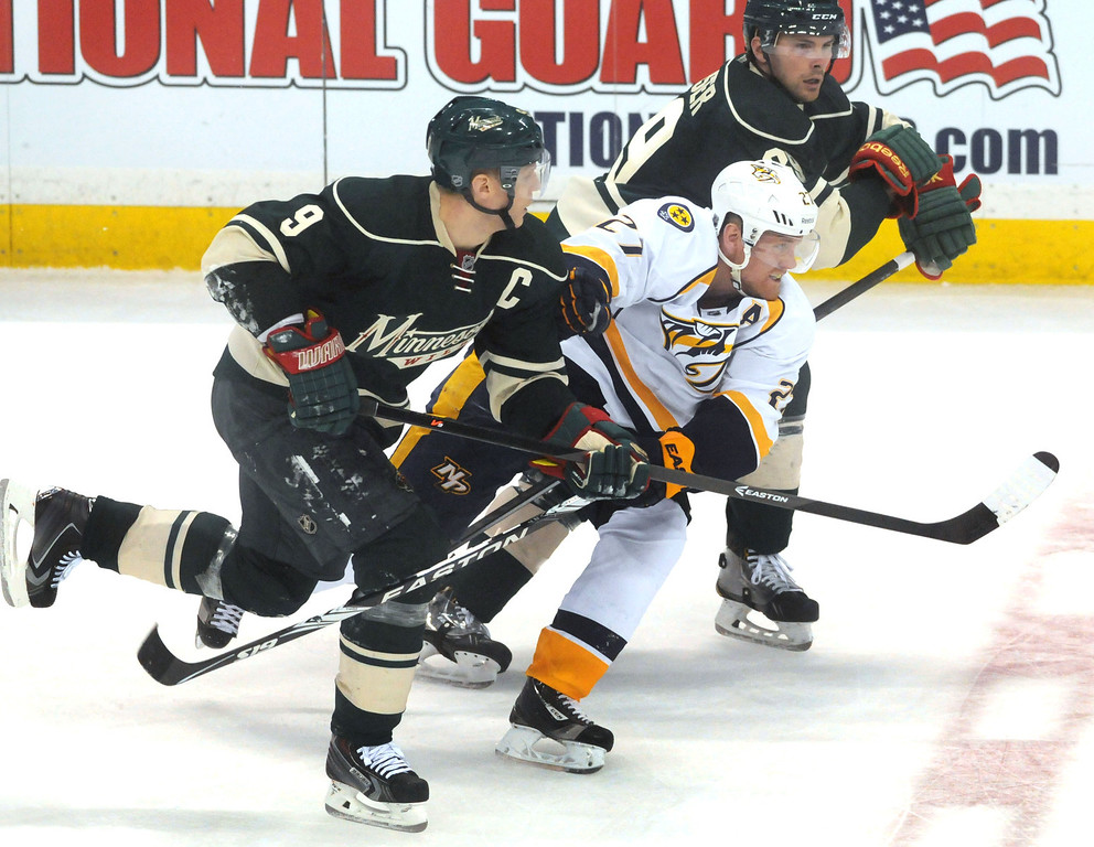 . Nashville\'s Patric Hornqvist is sandwiched between the Wild\'s Mikko Koivu, left,  and Nate Prosser in the third period as the Minnesota Wild lost 7-3 in their last game of the season.  (Pioneer Press: Scott Takushi)