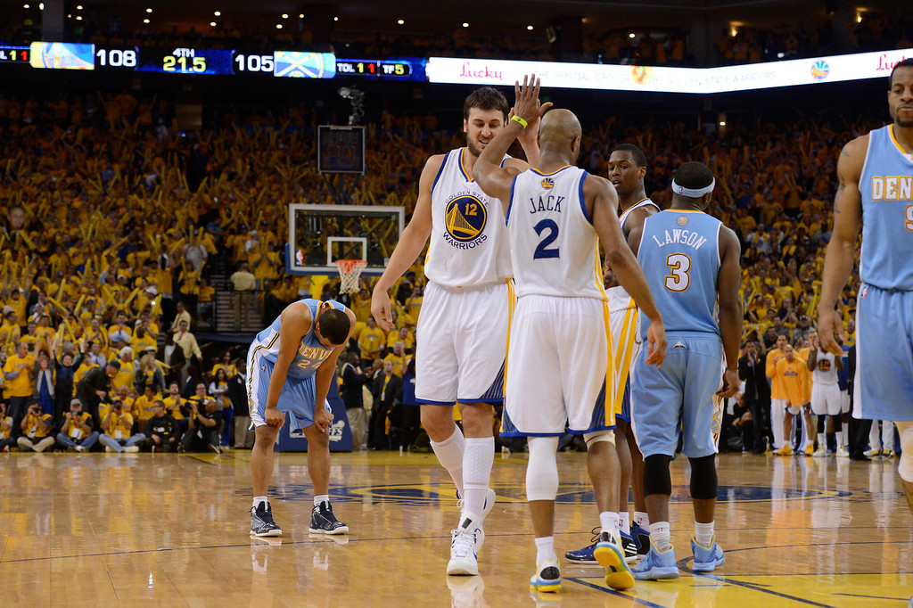 . OAKLAND, CA. - APRIL 26: Andre Miller (24) of the Denver Nuggets leans over dejected with 21.5 second left in the fourth quarter as Andrew Bogut (12) of the Golden State Warriors high fives Jarrett Jack (2) in game 3 of the first round of the NBA Playoffs April 26, 2013 at Oracle Arena.  (Photo By John Leyba/The Denver Post)