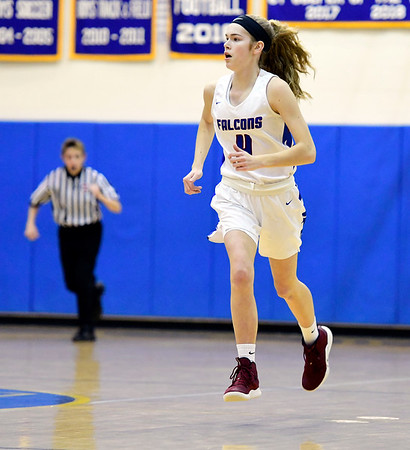 3/8/2019 Mike Orazzi   Staff St. Paul Catholic High Schools Olivia Heslin (4) during the Class S Semifinal girls basketball game with Trinity Catholic at Newtown High School Friday night in Newtown.